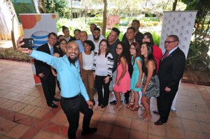 """A group of students pose for a """"selfie"""" with Sacred Heart University Gilberto Marxuach-Torrós (far left) and Ray Flores, AT&T Puerto Rico regional vice president, (far right.)"""