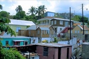 Wood-and-zinc houses crowd a hillside outside Basseterre, capital of the twin-island republic of St. Kitts & Nevis — smallest independent nation in the Western Hemisphere. (Credit: Larry Luxner)