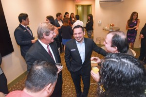 Hampton Inn General Manager Michael García, center, mingles with guests during the donation ceremony at the hotel.