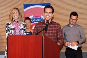 Brandom Cruz-González, at podium, is one of the three UPR students who won this year's video competition.