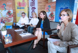 Clarisa Jiménez (holding microphone) offers details of the Saborea fest, flanked to her right by Ingrid Rivera, Chef Cielito Rosado and Chef Augusto Schreiner.