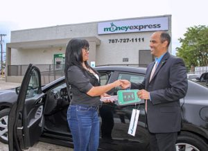 Normaris Reyes received her car at the new Money Express branch facilities in Santurce.
