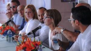 PRHTA President Clarisa Jiménez (at microphone) offers details of this weekend's culinary extravaganza. (Credit: Joe Colón)