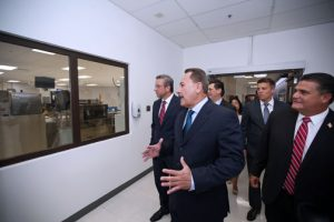 Miguel Centeno, general manager Roche Operations Ltd. in Ponce, leads Gov. García-Padilla and other government officials during a tour of the Ponce plant.