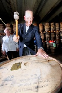 Wayne Chaplin, [resident of Southern Wine & Spirits seals the barrel of Bacardí rum.