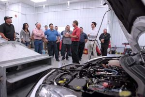 A group of mechanics and auto racing pilots during a quality test at Afton Chemical's Virginia-based R&D labs.