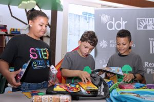 Boys & Girls club participants check out the back-to-school supplies.