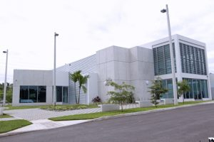 The modern, multi-story structure houses advanced technologies and specialized equipment, large kitchen areas and laboratories.