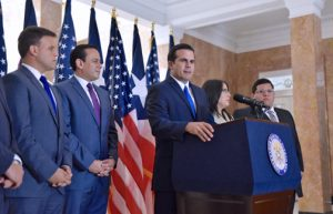 Gov-elect Ricardo Rosselló is flanked by his new appointees during a news conference Monday.
