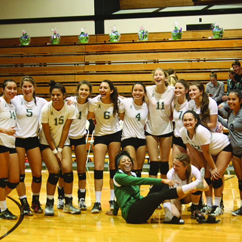 The UCC Riverhawks women's volleyball team celebrates and poses after victory over SWOCC.  Corden Drift / The Mainstream