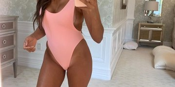 Real Housewives of New Jersey star Melissa Gorga sets pulses racing in an electric pink swimsuit