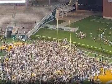 WATCH: Overjoyed Baylor fans storm field in Texas after NCAA title win... but predictable Covid sniping is quick to follow