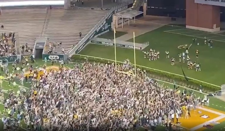 WATCH: Overjoyed Baylor fans storm field in Texas after NCAA title win… but predictable Covid sniping is quick to follow