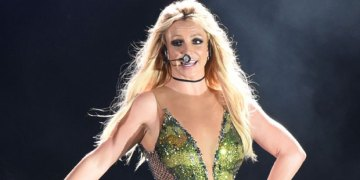 Britney Spears Stuns In Green Mini-Skirt, Sexy Sheer Catsuit & More In New Transformation Video