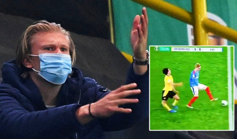 Look away now: Sickened Erling Haaland can't watch as teammate