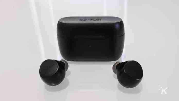 black earbuds on table