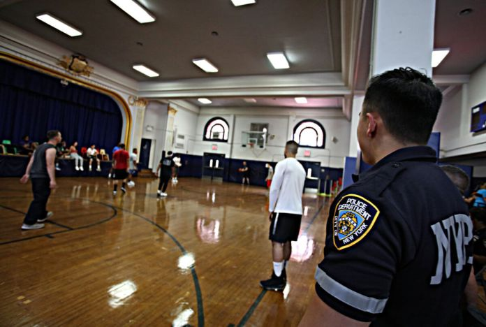 Kids and cops team up to feed Harlem community