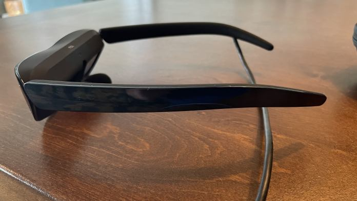 Glasses sitting on a table with long extending from arm.