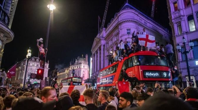 Riot police and 20 arrests as London goes wild after England win – fans surfing off BUSES