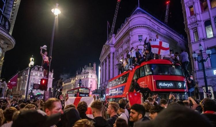 Riot police and 20 arrests as London goes wild after England win - fans surfing off BUSES