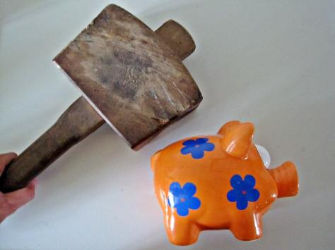 """""""Smashing a Piggy Bank"""" by Images_of_Money is licensed under CC BY 2.0"""
