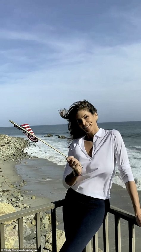 Team USA: Crawford waved an American flag as she took in the ocean breeze