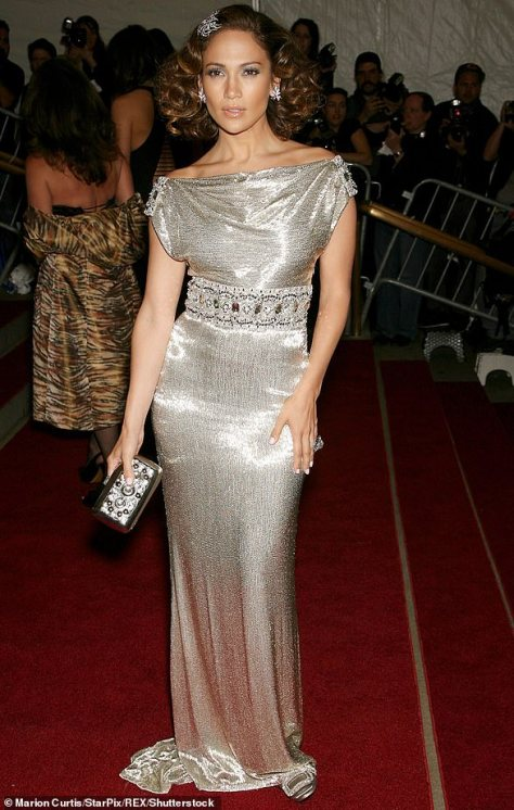 In 2007: There was a 1920s influence for this shimmery silver dress that was off the shoulder and had a dazzling belt as she added a hair clip that matched her earrings and clutch purse