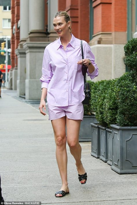 Lovely: The stunning supermodel, who celebrated her 29th birthday the day before, was seen in a lavender dress-shirt and shorts set as she strolled to a waiting limo