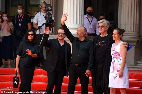 Special guests: (L-R) The couple and German film director Wim Wenders (R) were greeted by Sarajevo Film Festival's general manager Mirsad Purivatra (C) on the red carpet