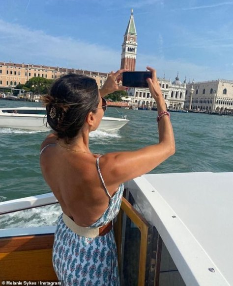 Stunning: In one social media snap, Melanie revealed her toned back and sun-kissed complexion in a backless dress as she captured the landscape