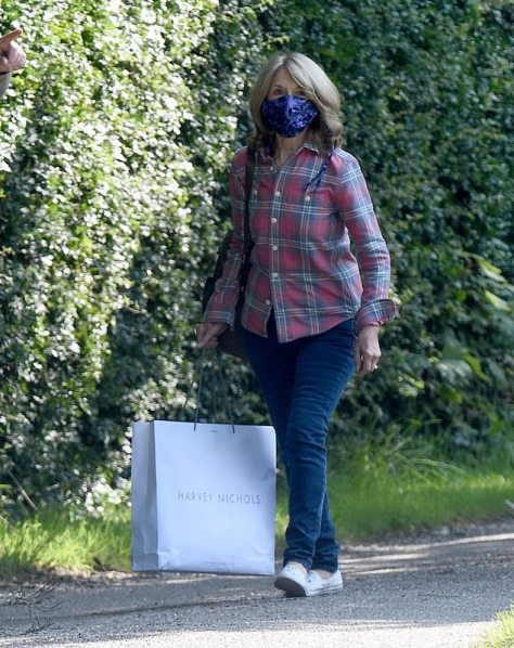 Arrival: Arriving for a day of filming in jeans and a plaid shirt, Helen was sporting a face mask and carrying a large shopping bag before getting into character