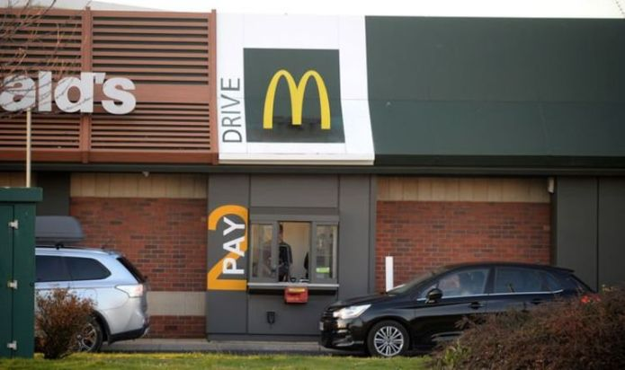 McDonald's monitors drivers as they wait at the drive-thru lane. claims former worker