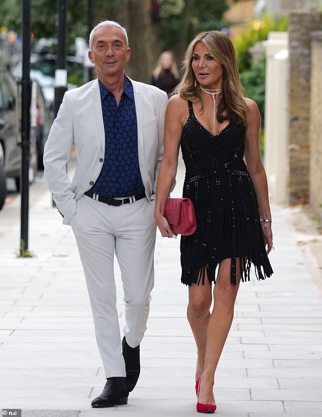 Friends in high places: The former WAG left plenty of skin on show thanks to the plunging neckline of her garment as she was joined by friend Bruno Tonioli, 65