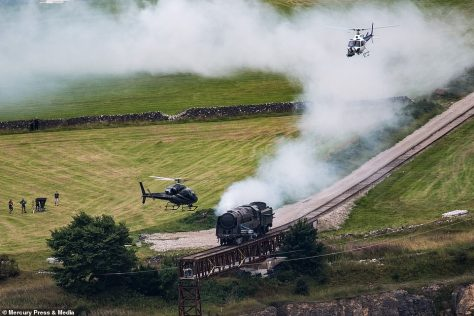 Upcoming film: Action-packed snaps showed a steam train falling off a cliff, with helicopters circling around the track