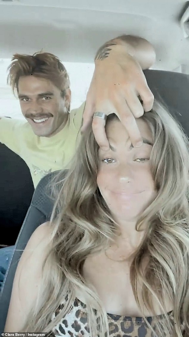 Joking around: In the first clip, Apa reached over from the backseat to playfully put his hand on Berry's forehead and pull her eyebrows up with two fingers as the two laughed
