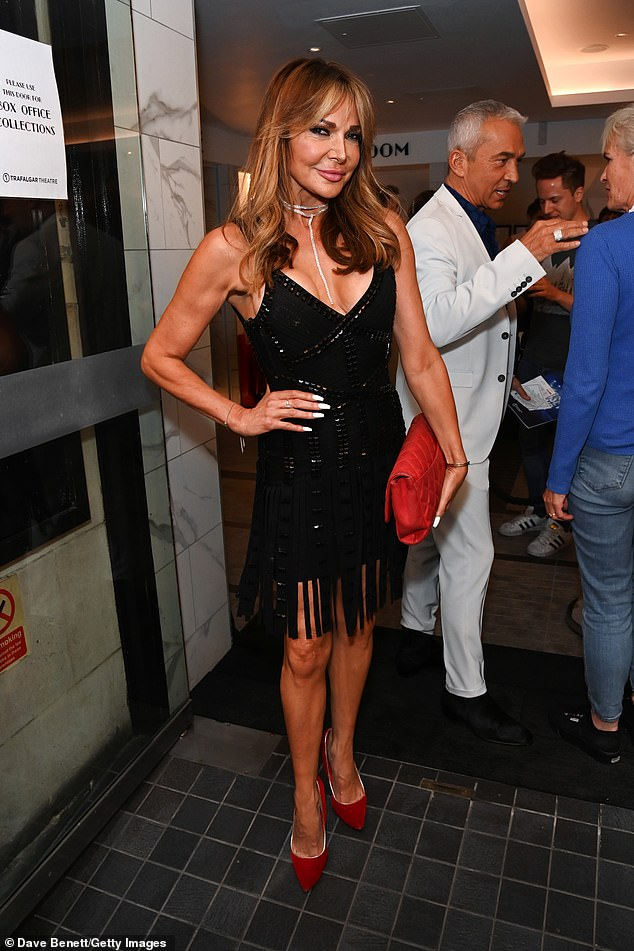 Strike a pose: Once at the theatre, Lizzie posed up a storm for awaiting photographers before she and Bruno chatted to tennis player Andy Murray's mother Judy