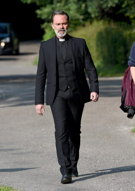 Cast: Also shooting funeral scenes mid-week was Billy Mayhew who was wearing his priest's collar