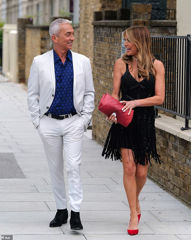 Style queen: The television personality opted for a pair of red high heeled shoes which she teamed with a matching purse with her highlighted hair resting on her shoulders