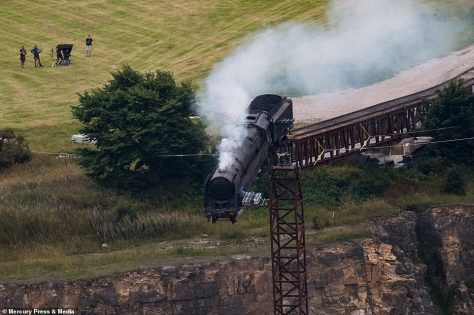 The seventh instalment: A dramatic scene featuring a steam train falling off a cliff in Derbyshire was filmed for the new Mission Impossible movie in Derbyshire on Friday