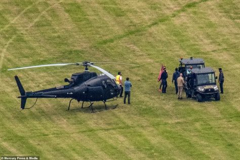 Big entrance: Tom was reportedly in black, walking towards the golf buggy