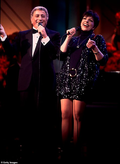 Making it work: The singer's son Danny expressed that, despite being diagnosed with Alzheimer's Disease, his father 'continues to sing and stay fit on a daily basis'; Bennett is seen performing with Liza Minelli in 1992