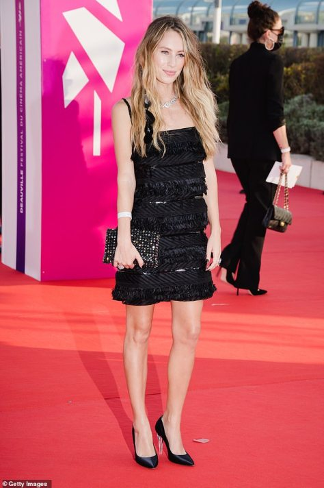 Confidence: The model looked flawless as she strutted onto the red carpet in a pair of black satin heels and toted a matching bedazzled clutch