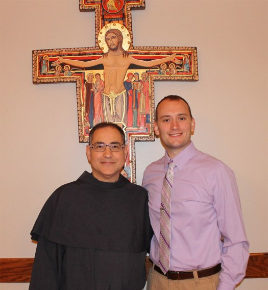 Current Director, Friar Rick Riccioli, OFM Conv., and incoming Director, Mr. Alexander (A.J.) LaPoint in front of the San Damiano Cross.