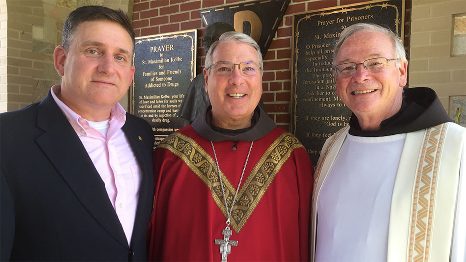 Mark Sherman (left), a former student of Bishop Hartmayer at Archbishop Curley High School, greeted him and Fr. Martin Kobos, OFM Conv., founder of the Companions of St. Anthony, at a 2016 Mass at the Shrine of St. Anthony in Ellicott City, MD, to commemorate the 75th anniversary of the death of St. Maximilian Kolbe.