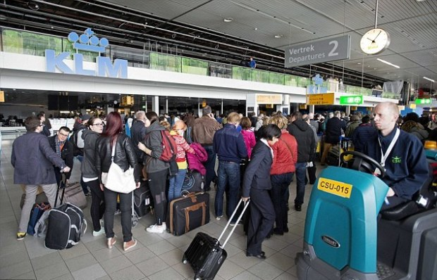 Passengers lining up at Schiphol airport in Holland