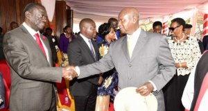 Besigye and Museveni Shaked Hands Once Again at Namugongo