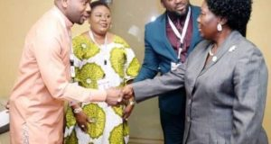 Desmond Elliot Shakes Hands With Rebecca Kadaga