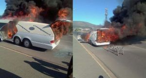 Hearse Carrying Coffin Catches Fire