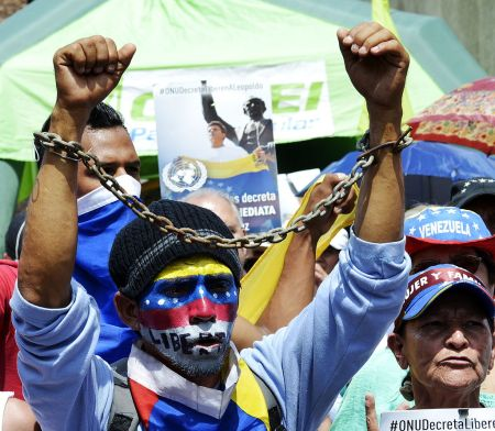 Protester with hands symbolically chained