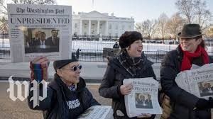 People passing out the Yes Men version of the Washington Post. Credit: Washington Post